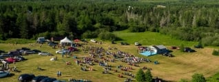 aerial view of a festival in a green valley