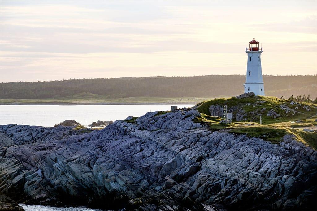 A lighthouse overlooks a rocky landscape