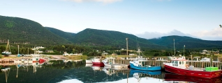 A quiet marina surrounded by mountains