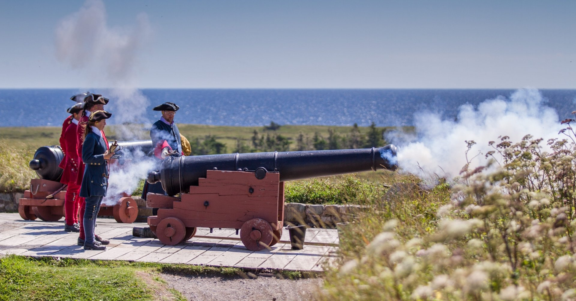 Men in period clothes set off a cannon