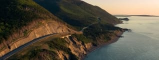 A highway winds through the coastline