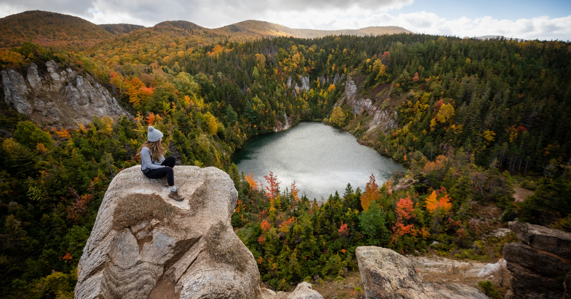 hiker stop to admire the fall foliage at the Gypsum Mine Quarry trail