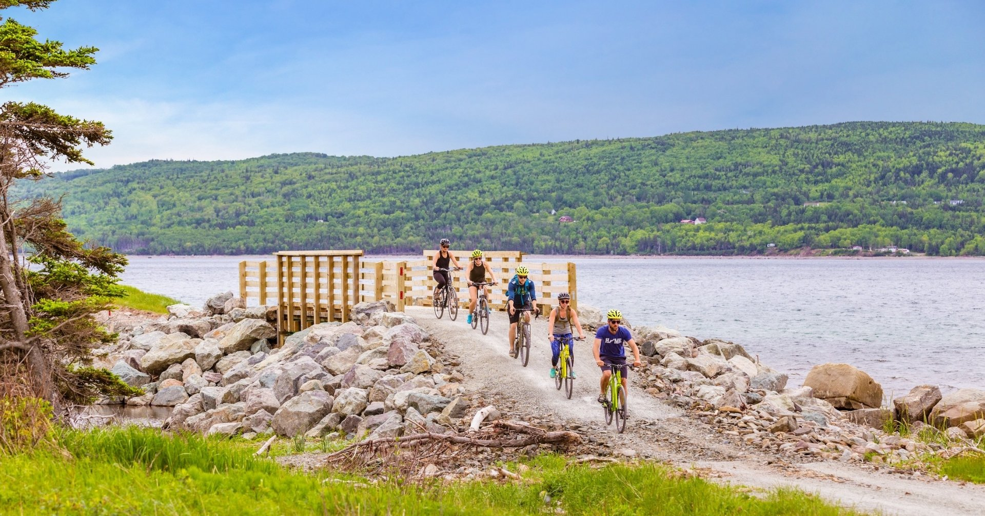 five riders bike along the coast
